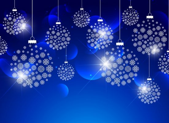 christmas balls made with snowflakes hanging on blue background